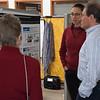 ECE Specialist Beth Pratt-Sitaula chats with UNAVCO President Meghan Miller and Director of Geodetic Infrastructure Glen Mattioli at her poster during the 2018 AGU@UNAVCO. January 16, 2018. Boulder, Colorado. (Photo/Daniel Zietlow, UNAVCO)