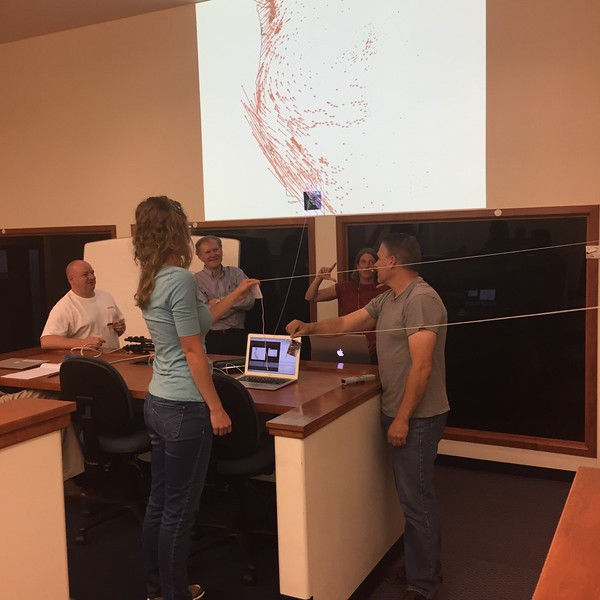 UNAVCO outreach specialist and former field engineer Beth Bartel teaches coworkers about the how and why of GPS during UNAVCO's internal GPS Basics training. (Photo/Aisha Morris, UNAVCO)