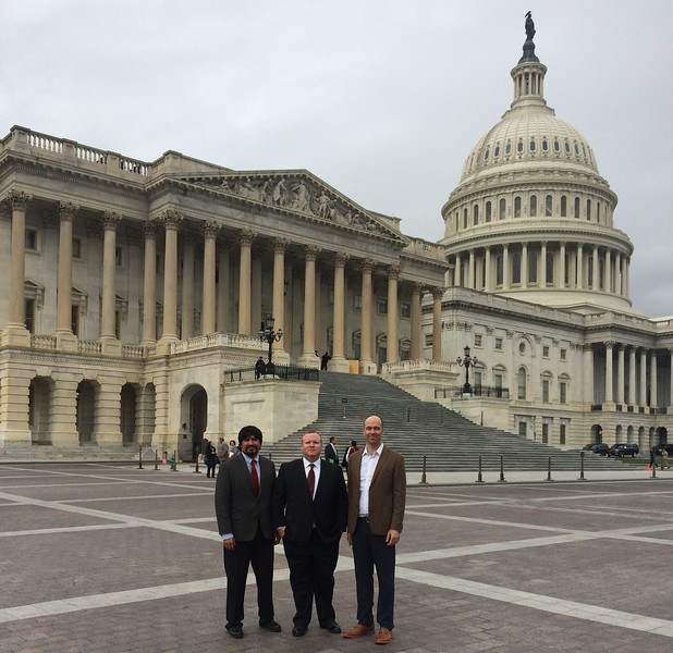 left to right: professors Oliver Rosales, Andrew Bond and Josh Ottum stand in front of the US Capitol building.