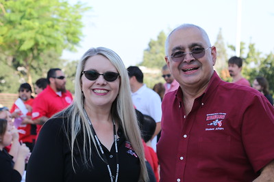 Michelle Pena (Acting Director -- A&R) and Zav Dadabhoy (Vice President -- Student Affairs) share some laughter with our team.