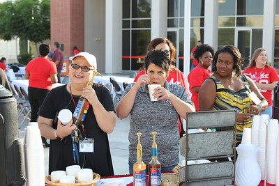 Cheryl Caswell (Department Assistant -- DSPS), Danyel Ritter (Department Assistant -- Student Life), and Adeana Williams (Department Assistant -- Veterans Center) visit the much needed coffee bar, while ushers Jordaun Bennett (Department Assistant -- Welcome Center) and Tanisha Gonzalez (Department Assistant -- A&R) greet our attendees in the background.