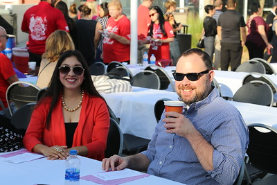 Pearl Urena (Educational Advisor -- Counseling), and Josh Shackelford (Educational Advisor -- Counseling) catch some rays and sip some joe as they wait for the doors to open.