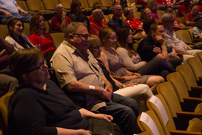 Liz Rozell sits in the Indoor Theater with her family and Kate Pluta.