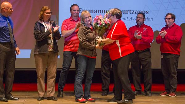 Liz Rozell is presented an award from the Management Association