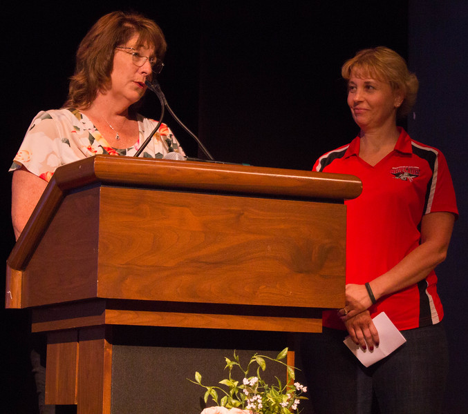 Cindy Collier and Billie Jo Rice speak at Liz Rozell's retirement.