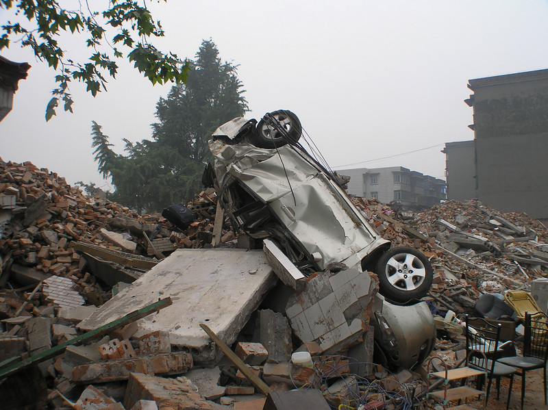 At the township of Hanwang, Mianzhu, the township government building collapsed. A car was left on the pile of rubble.