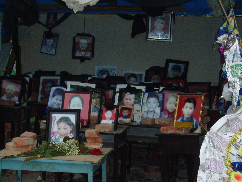 The framed pictures of school children (most 5th and 6th graders) who were killed by the collapsed building in the township of Fuxin, Mianzhu.