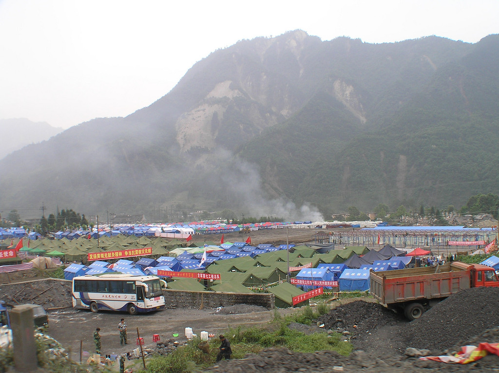 Against the mountain striped by landslides, tents were built for soldiers (the green ones) for the civilians (the blue ones) in Hongbai Township, Shifang.
