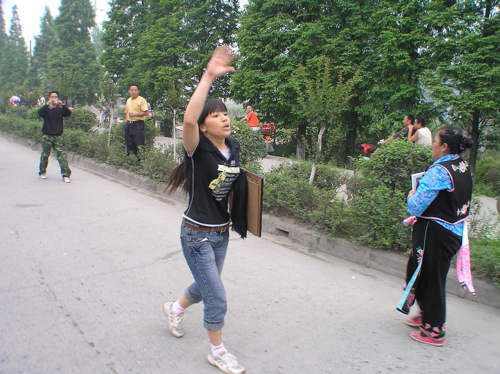 Zhang Xuemei, a young mother and a shop owner, lost her daughter—a dancing star in the local dancing school and became an active leader of the march.