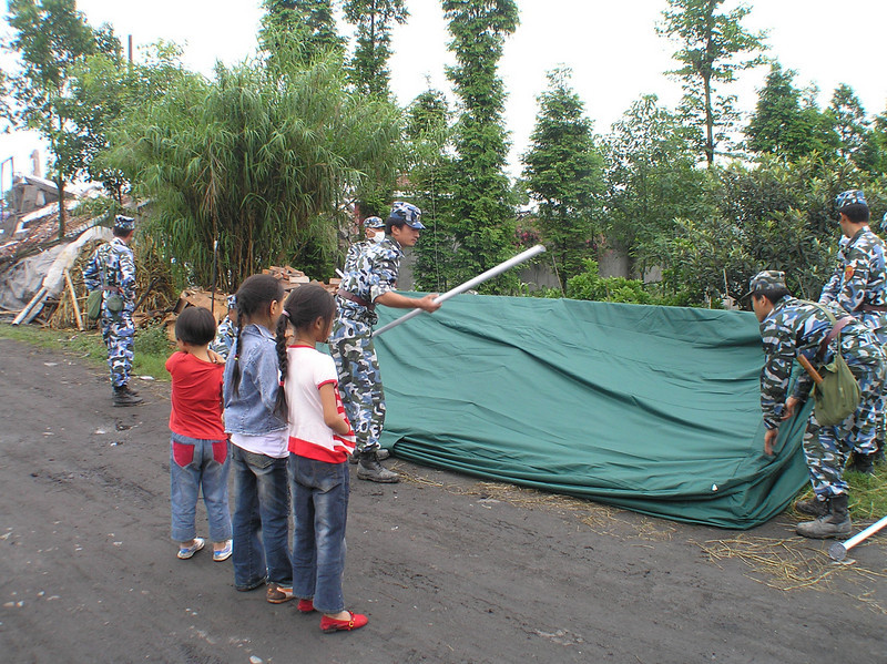 The soldiers were sent to the quake zone to build tents for the victims in Tianqi Village, Mianzhu.