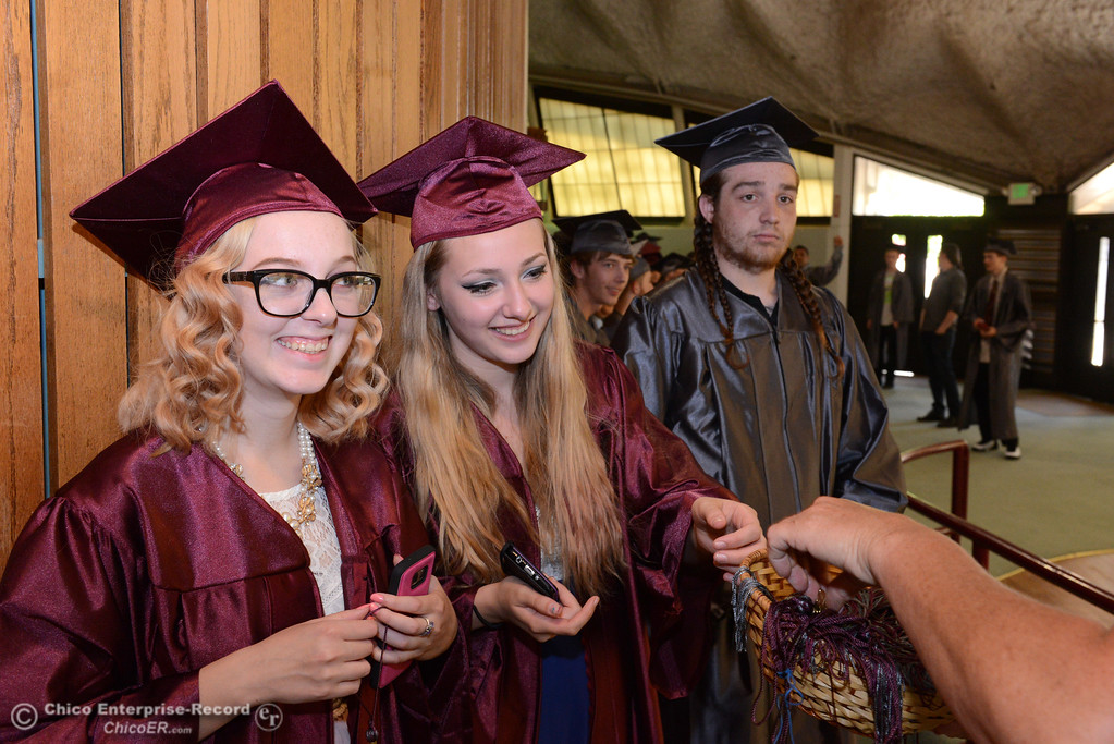 . Left to right, Jadea Nash, Amethyst Beacon, and Dominic Donato get their graduation tassel from Sherri Boone as Fair View High School\'s class of 2017 graduates Tuesday, June 6, 2017, at Neighborhood Church in Chico, California. (Dan Reidel -- Enterprise-Record)