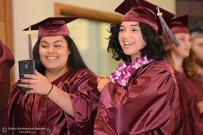Veronica Cuin, left, and Brittany Duran smile as they take photos just before Fair View High School's class of 2017 graduates Tuesday, June 6, 2017, at Neighborhood Church in Chico, California. (Dan Reidel -- Enterprise-Record)
