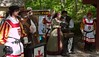 Ticket takers; three royal guards, Anne Boleyn, and other members of the court.