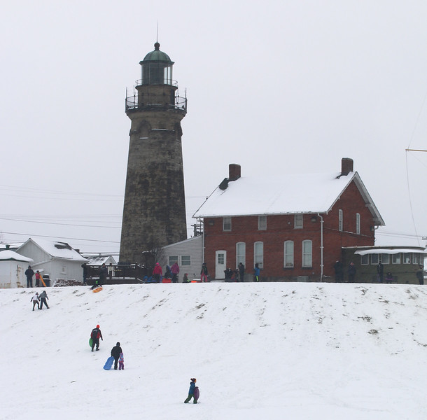Jonathan Tressler - The News-Herald <br> A neighborhood favorite on snow days, the hill on the north side of the Fairport Harbor Marine Museum and Lighthouse gets used accordingly in this Jan. 31, 2017 photo.