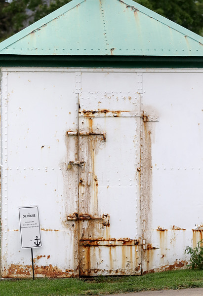 Jonathan Tressler - The News-Herald <br> The oil house, from where a century's worth of lighthouse keepers obtained fuel for the lighhouse's namesake, is one of the property's fixtures requiring routine maintenance and painting, as the rust pictured in this Aug. 4 photo illustrates.
