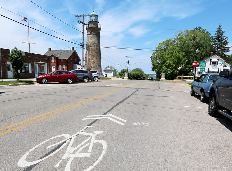 Jonathan Tressler-The News-Herald <br> Fairport Harbor's Historic Lighthouse still serves as a familiar landmark for all manner of travelers today, whether they come by boat, by foot, by car or by bike.