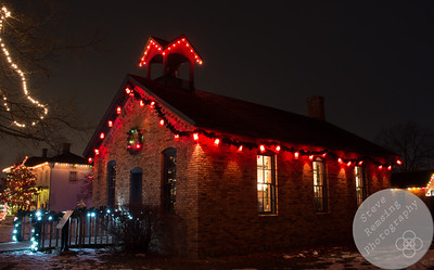 Crossroads Village in Flint, MI Christmas light display.  The village school house.
