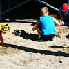 Christopher Aune | The Herald-Tribune<br /> Young siblings of 4-H members find many activities to while away the hours at the Brookville fairgrounds. Playing with sand is just one of them.