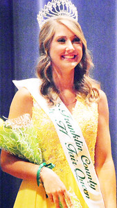 Will Fehlinger | The Herald-Tribune Ashlie Raible smiles for the audience after being named the 2017 Franklin County 4-H Fair Queen Sunday night at Franklin County High School.