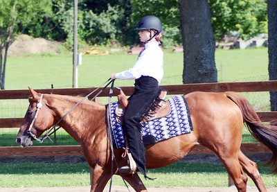 Will Fehlinger | The Herald-Tribune Sarah Schuman leads her horse into the show ring on the second day of the Franklin County 4-H Fair Horse and Pony Show July 16.
