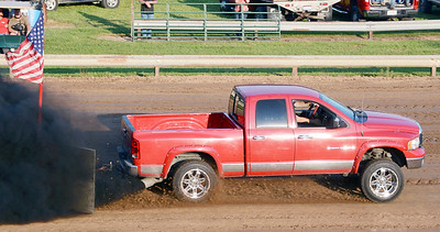 Will Fehlinger | The Herald-Tribune A 2005 Dodge truck from Connersville leaves a trail of diesel smoke to start Wednesday night's truck and tractor pull at the Franklin County 4-H Fair. The pulls continued Thursday with flat drag races scheduled today and Saturday.