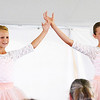 "Will Fehlinger | The Herald-Tribune<br /> Maria Lanning, left, and Anna Helmers curtsy following their ballet duet entitled ""Alice"" at the Franklin County 4-H Fair Talent Show on July 19. The girls are both members of the East Franklin Flyers."