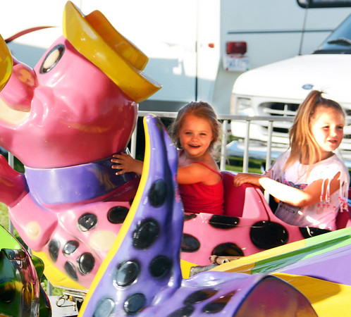 Will Fehlinger | The Herald-Tribune<br /> Brooklyn Bulmer and Candace Hundley, both 5, Laurel, enjoy one of the many children's rides at the Franklin County 4-H Fair, which continues through Saturday in Brookville.