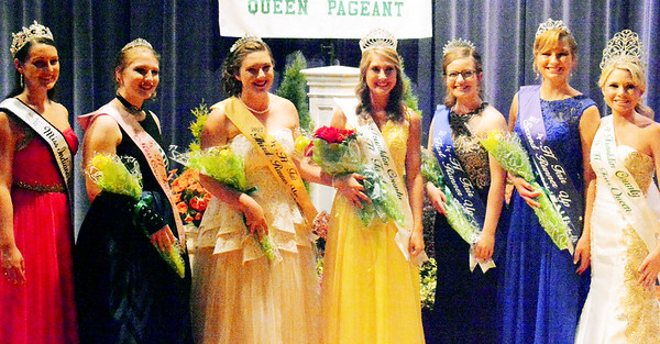 Will Fehlinger | The Herald-Tribune Franklin County Fair Queen Court members stand between reigning Indiana State Fair Queen Becca Lax (left) and 2016 Franklin County Queen Madison Payne (right). Miss Congeniality Alexa Brehm (from second from left), third runner-up Clare Weidner, Queen Ashlie Raible, first runner-up Shelby Kolb and second runner-up Tori Volk make up the court.