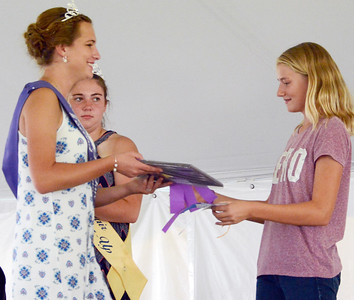 Will Fehlinger | The Herald-Tribune Franklin County 4-H Fair second runner-up Tori Volk awards Hanna Mullins her grand champion prize in the intermediate division of the 4-H Pet Show July 19 in Brookville.