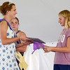 Will Fehlinger | The Herald-Tribune<br /> Franklin County 4-H Fair second runner-up Tori Volk awards Hanna Mullins her grand champion prize in the intermediate division of the 4-H Pet Show July 19 in Brookville.