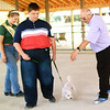 Debbie Blank | The Herald-Tribune<br /> Ron Gibson (from right) judges Oxford Pike Pioneers member Howie Kroll, 17, Okeana, Ohio, and his Bichon Frise, Kirby, on obedience while Franklin County 4-H Fair Queen Pageant third runner-up Alexa Brehm, 19, Cedar Grove, assists.