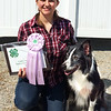 Debbie Blank | The Herald-Tribune<br /> Karen Kahles, 17, Cedar Grove, and her Australian shepherd Molly celebrate earning a Reserve Grand Champion ribbon in Beginner B agility.