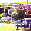 Diane Raver | The Herald-Tribune<br /> Kirstyn Caudill (right), 10, Brookville, and Joleen Ridenour, 10, Oxford, Ohio, were hanging on tight as the Star Trooper ride spun them up and down, forward and backward. This was one of several amusements set up by Funtime Carnival for fairgoers to enjoy.