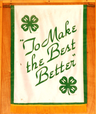 Debbie Blank | The Herald-Tribune<br /> Banners throughout the fairgrounds remind 4-H members of their goal.