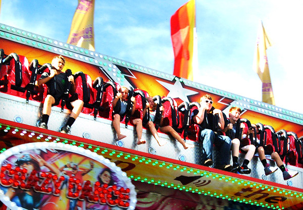 Debbie Blank | The Herald-Tribune<br /> This Crazy Dance amusement gives riders a bird's-eye view of the fairgrounds.
