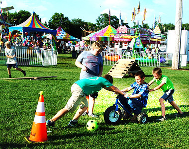 Debbie Blank | The Herald-Tribune Before the obstacle course contest began, boys frolicked at that area.