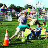 Debbie Blank | The Herald-Tribune<br /> Before the obstacle course contest began, boys frolicked at that area.