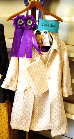 Debbie Blank | The Herald-Tribune Spectators gathered around the prizewinning sewing exhibits. Tenth-grader Josie Selm's coat and purse in the sewing advanced division captured Grand Champion and were selected to be exhibited at the Indiana State Fair.