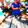 Debbie Blank | The Herald-Tribune<br /> She was littler, but quicker: Alice Bulmer (right), 7, Brookville, the fair's Miss Personality, beat Ben Stern, 17, Franklin, in the first heat of the pie-eating contest. The loser got a pie in the face (whipped cream, actually) from the winner.