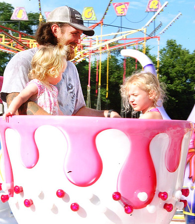 Debbie Blank | The Herald-Tribune When it's hot, riding in a whirling teacup is one way to cool off.