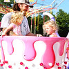 Debbie Blank | The Herald-Tribune<br /> When it's hot, riding in a whirling teacup is one way to cool off.