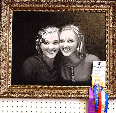Debbie Blank | The Herald-Tribune<br /> Superkids 4-H Club member Veronica Hartman, an 11th-grader, received blue, special merit and champion ribbons for her drawing of two young women in the fine arts advanced division. The artwork is eligible to be displayed at the state fair.