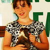 Debbie Blank | The Herald-Tribune<br /> Beleah Warren of the Udder Cream Gang entered guinea pig Marshmallow in the pet show beginning division.