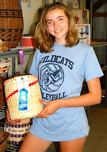 Debbie Blank | The Herald-Tribune Daphne Stokes, 13, West Harrison, came to one building to admire her cousin's basket. Brookville Lakers member Moorea Nobbe gained a blue ribbon in the intermediate basketry category.