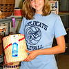 Debbie Blank | The Herald-Tribune<br /> Daphne Stokes, 13, West Harrison, came to one building to admire her cousin's basket. Brookville Lakers member Moorea Nobbe gained a blue ribbon in the intermediate basketry category.