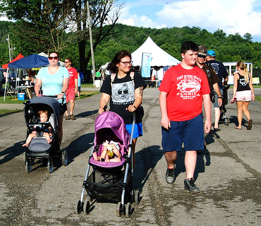 Debbie Blank | The Herald-Tribune<br /> People flock to the fair after 4 p.m. to view exhibits, watch free shows, grab supper and catch up with friends.