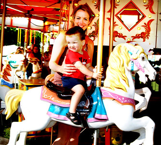 Debbie Blank | The Herald-Tribune In between bursts of rain, the carousel was the perfect place to catch a breeze.