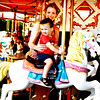 Debbie Blank | The Herald-Tribune<br /> In between bursts of rain, the carousel was the perfect place to catch a breeze.
