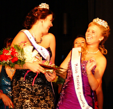 Debbie Blank | The Herald-Tribune<br /> Just after Ashley Moore (left) received her tiara, she shares a joyful moment with outgoing Queen Katie Huffman.