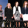 Debbie Blank | The Herald-Tribune<br /> Looking very businesslike were (from left) Faith Lafary and Andrea Grossman, Versailles; Kiesten Abel, Osgood; Emily Cumberworth, Holton; and Carly Buchanan, Versailles. With them is master of ceremonies Jacob Boles.